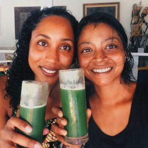 sisters drinking green juice